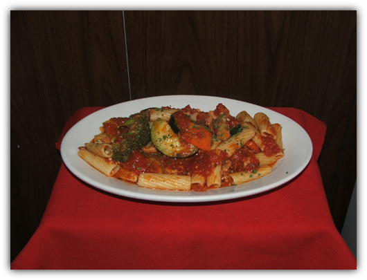 Rigatoni Primavera sauteed with fresh vegetables and tomato sauce.