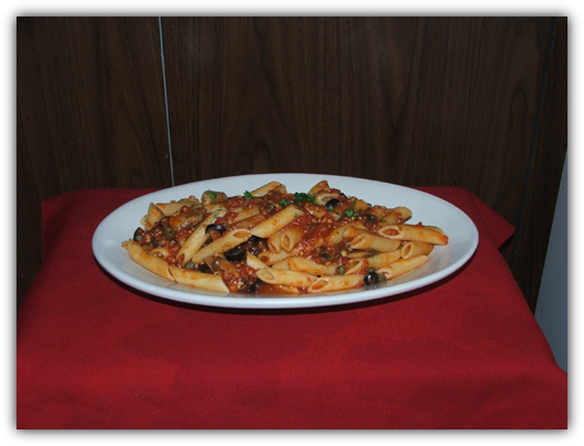 Penne Puttanesca with mushrooms, capers, black olives and tomato sauce.