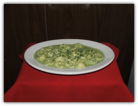 Tortollini Al Pesto. Stuffed with veal or cheese with a green pesto sauce.